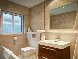 Photo - Luxurious fitted bathrooms installed to various rooms in a Lake District hotel