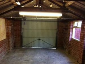 Garage Clearance (3 of 3) - The cleared garage with cobwebs cleaned away, ready for its new owners