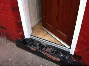 Wooden Door Frame Repair (3 of 3) - The finished repair painted to look like new, giving the door a new lease of life