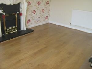 Laminate Flooring (2 of 2) - The finished laid floor with sound boarding underneath to reduce noise when walking on it