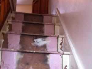 Carpet Fitting (1 of  3) - The staircase of a Lancaster home prepared for a new carpet with existing nails and gripper rods removed
