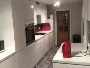 Modern Kitchen - Contemporary fitted kitchen for a Preston home, making good use of available space