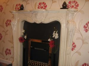 Wall-papering - Distinctive decorative wall-paper applied to a wall with a feature fireplace in a home in Penwortham, Preston